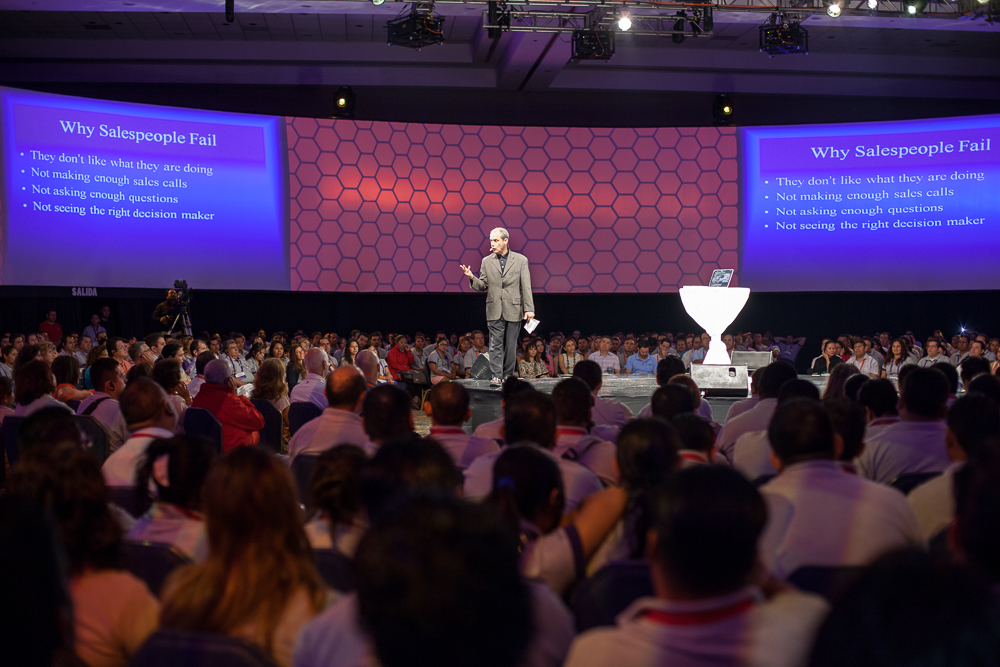 Hal Becker, sales trainer Cleveland Ohio, on stage giving one of his famous speeches to a large audience.