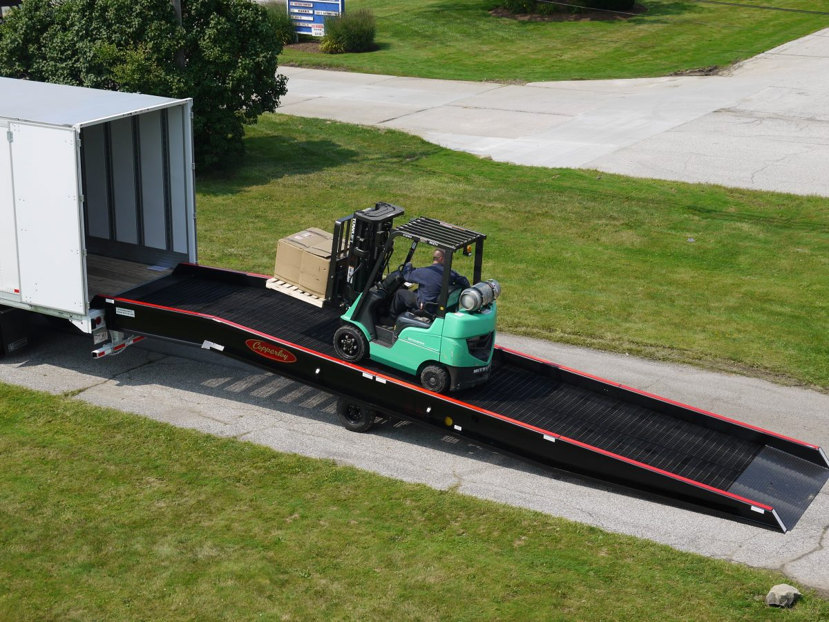 A forklift traveling on one of Copperloy's forklift ramps.