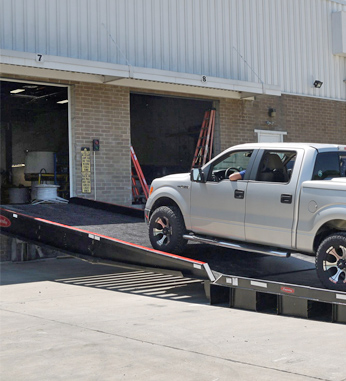 truck moving up portable loading dock ramps for sale